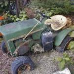 John Deere 112H resting in the back yard